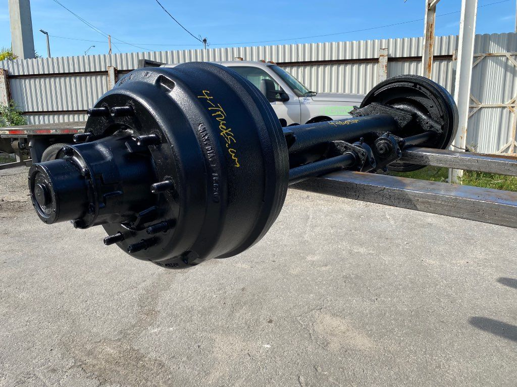 "1998 HENDRICKSON TRAILER AXLES  96"", BUDD HUBS, SPOKE HUBS AND PILOT METRIC HUBS"